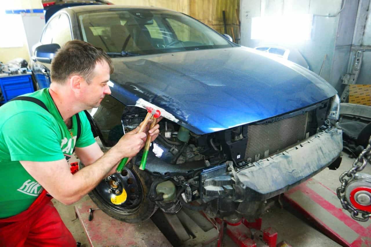 Фото процесса ремонта капота